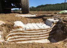 Illustration du tassement opéré par un pneu sur les différents horizons du sol